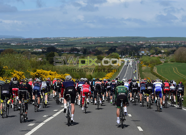 Picture by Alex Broadway/SWpix.com - 01/05/2015 - Cycling - 2015 Tour de Yorkshire: Stage 1, Bridlington to Scarborough - The Peleton make their way through the Yorkshire countryside during Stage 1.
