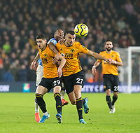 27th December 2019; Molineux Stadium, Wolverhampton, West Midlands, England; English Premier League, Wolverhampton Wanderers versus Manchester City; Ruben Vinagre and Romain Saiss of Wolverhampton Wanderers block Raheem Sterling of Manchester City in front of the ball