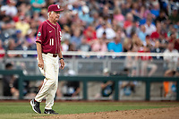 Florida State Seminoles Head coach Mike Martin (11) walks to the mound during Game 9 of the NCAA College World Series against the Texas Tech Red Raiders on June 19, 2019 at TD Ameritrade Park in Omaha, Nebraska. Texas Tech defeated Florida State State 4-1. (Andrew Woolley/Four Seam Images)