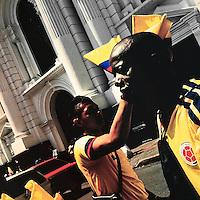 Colombian men sell football fan flags on the street in Cali, Colombia, 28 June 2014.