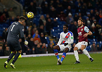 30th November 2019; Turf Moor, Burnley, Lanchashire, England; English Premier League Football, Burnley versus Crystal Palace; Burnley keeper Nick Pope heads clear as Jeffrey Schlupp of Crystal Palace bears down followed by Erik Pieters<br /> <br />  - Strictly Editorial Use Only. No use with unauthorized audio, video, data, fixture lists, club/league logos or 'live' services. Online in-match use limited to 120 images, no video emulation. No use in betting, games or single club/league/player publications