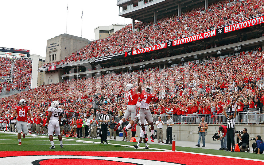 Ohio State Buckeyes wide receiver Michael Thomas (3) and Ohio State Buckeyes running back Jalin Marshall (17) celebrates Thomas's touchdown catch against Western Michigan Broncos in the 1st quarter of their game at Ohio Stadium on September 26, 2015.  (Dispatch photo by Kyle Robertson)