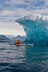 Sea kayaker, Iceberg, Columbia Bay, Columbia Glacier, Prince William Sound, Alaska, USA