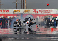 Mar. 6, 2009; Bakersfield, CA, USA; Nostalgia top fuel dragster driver Dan Horan goes airborne after crashing into Mike Chrisman during qualifying for the 51th annual March Meet at the Auto Club Famoso Raceway. Both drivers were ok. Mandatory Credit: Mark J. Rebilas-