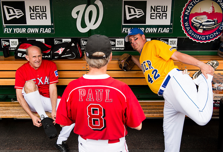 UNITED STATES - JUNE 13: Rep. Louie Gohmert, R-Texas, left, slips on a knee brace as Rep. Jeff Duncan, R-Fla., right, stretches while talking with Sen. Rand Paul, R-Ky., in the Republicans' dugout before the 52nd annual Congressional Baseball Game at national Stadium in Washington on Thursday, June 13, 2013. (Photo By Bill Clark/CQ Roll Call)