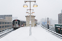 A Flushing Line trains arrives at the Queensboro Plaza station in New York during the city's first major winter storm of the season on Thursday, February 9, 2017. Meteorologists are forecasting between 8 and 14 inches of snow in the New York City region. The Metropolitan Transportation Authority has had no major delays and the trains continue to run.  (© Richard B. Levine)