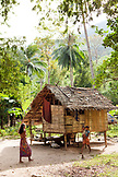 PHILIPPINES, Palawan, Barangay region, Batak family by their home in Kalakwasan Village