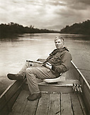 BRAZIL, Agua Boa, portrait of a fly fisherman sitting in a boat on a tributary of the Amazon River, Agua Boa River and resort