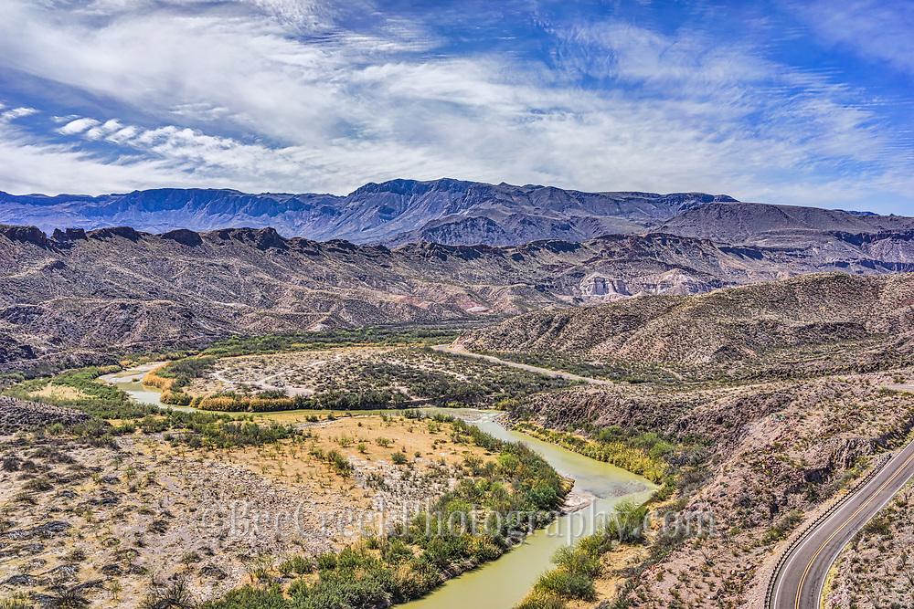 An Aerial view of the Rio Grande River as it flow through west Texas along the boder of Texas and Mexico. You can see the Mexico mountains and the River Road below in the Big Ben State park.