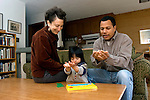 "Berkeley CA Adoptive parents and Guatemalan daughter, two-years-old, using signing to name ""boat"" in puzzle she's doing  MR"
