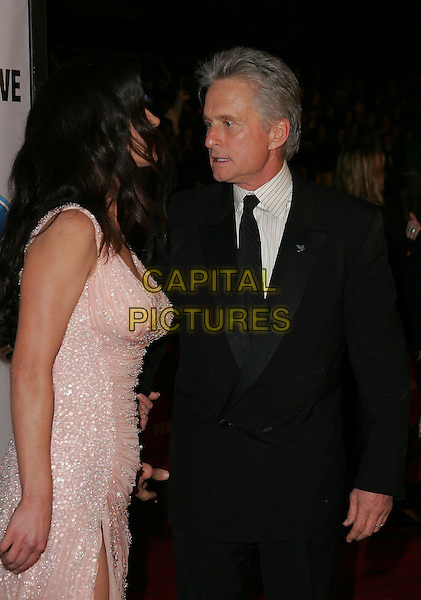 "CATHERINE ZETA-JONES & MICHAEL DOUGLAS.The Warner Brothers' World Premiere of ""Ocean's Twelve"" held at The Grauman's Chinese Theatre in Hollywood, California .December 8th,2 004.half length, celebrity couple, married, husband, wife, jewel encrusted.www.capitalpictures.com.sales@capitalpictures.com.Supplied By Capital PIctures"