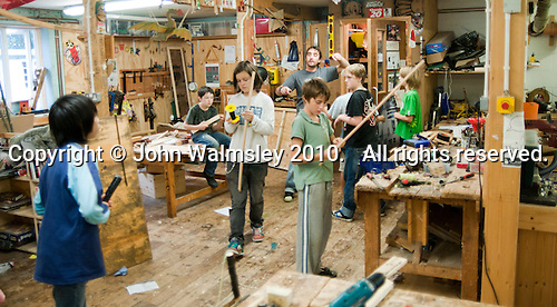 In the woodwork room, Summerhill School, Leiston, Suffolk. The school was founded by A.S.Neill in 1921 and is run on democratic lines with each person, adult or child, having an equal say.  You don't have to go to lessons if you don't want to but could play all day.  It gets above average GCSE exam results.