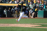 OAKLAND, CA - SEPTEMBER 20:  Ramon Laureano #22 of the Oakland Athletics scores a run against the Los Angeles Angels of Anaheim during the game at the Oakland Coliseum on Thursday, September 20, 2018 in Oakland, California. (Photo by Brad Mangin)