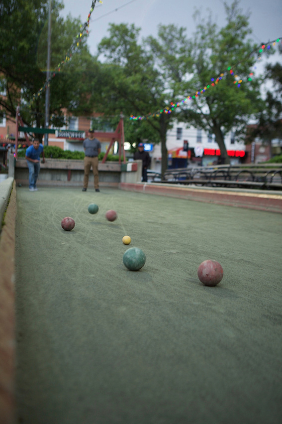 QUEENS, NY - May 6, 2017: Men playing Bocce at William F Moore Park in Corona. <br /> <br /> Credit: Clay Williams for 111 Places in Queens You Must Not Miss.<br /> <br /> &copy; Clay Williams / http://claywilliamsphoto.com