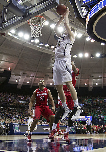 January 19, 2013:  Notre Dame guard Scott Martin (14) goes up for a rebound during NCAA Basketball game action between the Notre Dame Fighting Irish and the Rutgers Scarlett Knights at Purcell Pavilion at the Joyce Center in South Bend, Indiana.  Notre Dame defeated Rutgers 69-66.