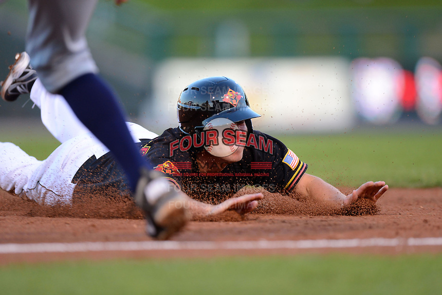 Rochester Red Wings shortstop Doug Bernier #7 slides head first into third during a game against the Scranton Wilkes-Barre RailRiders on June 19, 2013 at Frontier Field in Rochester, New York.  Scranton defeated Rochester 10-7.  (Mike Janes/Four Seam Images)