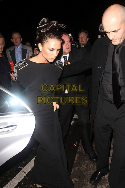 VICTORIA BECKHAM.The British Fashion Awards at Royal Courts of Justice, Strand, London, England..December 9th, 2009.full 3/4 length black hair up dress blue sapphire ring jewelled embellished posh spice car.CAP/AH.©Adam Houghton/Capital Pictures.