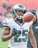 Philadelphia Eagles running back LeSean McCoy (25) flips the ball to a coach as he warms-up prior to the game against the Washington Redskins at FedEx Field in Landover, Maryland on Saturday, December 20, 2014.<br /> Credit: Ron Sachs / CNP