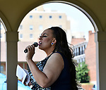 "Dieta Pepsi announces local St. Charles rock band ""Shots Fired"" at the Pride St. Charles Festival. She was mistress of ceremonies at the fourth annual event held at Frontier Park in St. Charles, Missouri on Saturday July 16, 2018. Dieta, also known as Leon Braxton, Jr., is a well-known female impersonator who uses a pronoun as a non-binary reference to herself. Non-binary is a catch-all category for gender identities that are not exclusively masculine or feminine."