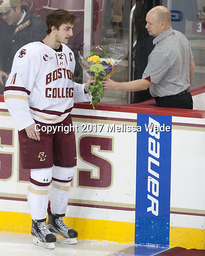 Chris Calnan (BC - 11), John Hegarty (BC - Director-HockeyOps) - The visiting University of Vermont Catamounts tied the Boston College Eagles 2-2 on Saturday, February 18, 2017, Boston College's senior night at Kelley Rink in Conte Forum in Chestnut Hill, Massachusetts.Vermont and BC tied 2-2 on Saturday, February 18, 2017, Boston College's senior night at Kelley Rink in Conte Forum in Chestnut Hill, Massachusetts.