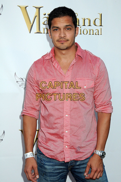 NICHOLAS GONZALEZ. 4th Annual Sports Dream Celebrity Poker and Pool Party Celebrating the 2010 ESPY Awards held at the Playboy Mansion, Beverly Hills, California, USA..July 12th, 2010.half length pink shirt .CAP/ADM/BP.©Byron Purvis/AdMedia/Capital Pictures.