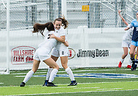 NWA Democrat-Gazette/BEN GOFF @NWABENGOFF<br /> Angelina Diaz and Lauren Parker of Bentonville celebrate after a goal by Parker vs Springdale Har-Ber Tuesday, March 12, 2019, in the first half of the match at Wildcat Stadium in Springdale.