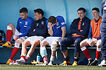 Andy Little in pain on the bench with ice packs and bandages on his legs
