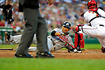 3 July 2009: Atlanta Braves first baseman Martin Prado slides home safely on a Chipper Jones RBI single in the 4th inning against the Washington Nationals at Nationals Park in Washington, DC. The Braves defeated the Nationals 9-8 to take the first game of the 3-game weekend series. Mandatory Credit: Ed Wolfstein Photo