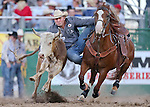 Tom Lewis competes in the steer wrestling competition at the Reno Rodeo in Reno, Nev., on Friday, June 20, 2014.<br />