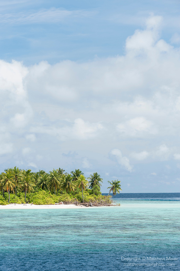 Mahadhdhoo Island, Huvadhoo Atoll, Maldives; a remote, deserted island in the Indian Ocean, with palm trees and white sand beaches, surrounded by a shallow coral reef