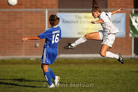 Sandy - Alta's Kealia Ohai scores with a mid-air kick. Bingham's Paige Densley defending. Alta vs. Bingham girls high school soccer, 5A playoffs, Thursday, October 16, 2008. Alta wins at home 5-0..
