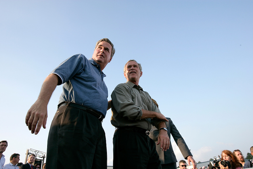 U.S. President George W. Bush and his brother Florida Governor Jeb Bush during a campaign election rally in Gainesville, Florida.