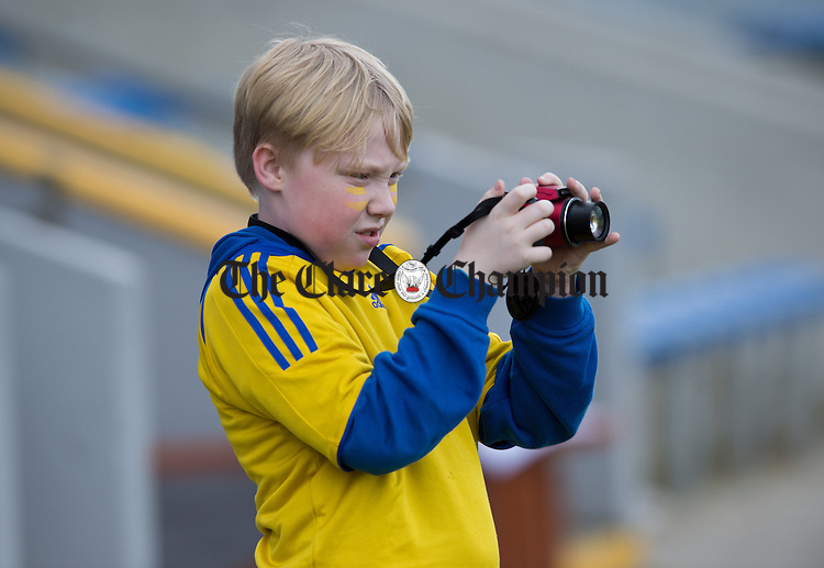 Ennis CBS's Scott Molloy taking pictures at the Cumann na mBunscoil Finals at Cusack Park. Photograph by John Kelly.