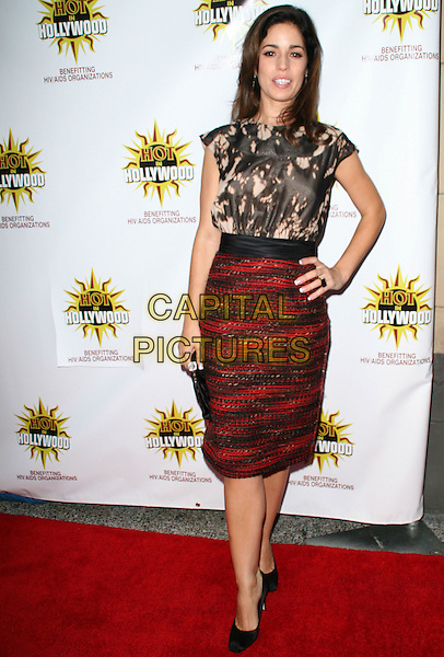ANA ORTIZ .3rd Annual Hot in Hollywood, held at Avalon, Hollywood, California, .USA, 16 August 2008..full length print black cream print top patterned skirt hand on hip shoes clutch bag .CAP/ADM/FS.©Faye Sadou/Admedia/Capital Pictures