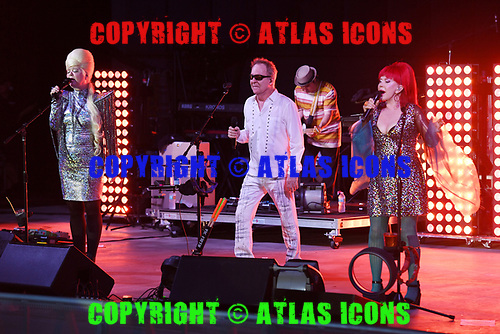 POMPANO BEACH FL - JULY 01: Cindy Wilson, Fred Schneider and Kate Pierson of The B-52's perform at The Pompano Beach Amphitheater on July 1, 2018 in Pompano Beach, Florida. Photo by Larry Marano © 2018