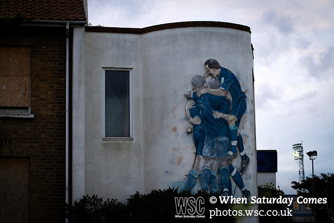 Southend United 1 Burton Albion 1, 22/02/2016. Roots Hall, League One. A mural on the exterior wall of the club shop at Roots Hall stadium, pictured before Southend United took on Burton Albion in a League 1 fixture. Founded in 1906, Southend United moved into their current ground in 1955, the construction of which was funded by the club's supporters. Southend won this match by 3-1, watched by a crowd of 6503. Photo by Colin McPherson.
