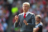 Arsenal manager Arsene Wenger on the touchline for the final time as Arsenal manager as Arsenal go close with a shot during the Premier League match between Huddersfield Town and Arsenal at the John Smith's Stadium, Huddersfield, England on 13 May 2018. Photo by Thomas Gadd / PRiME Media Images.