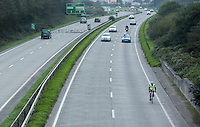 26 SEP 2013 - PENZANCE, GBR - Paul Gosney cycles along the A30 at Penzance, Cornwall, Great Britain during the Enduroman 2013 Lands End to London to Dover ultra triathlon (PHOTO COPYRIGHT © 2013 NIGEL FARROW, ALL RIGHTS RESERVED)
