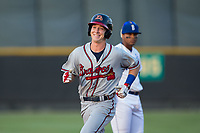 Drew Waters (12) of the Danville Braves is all smiles as he rounds the bases after hitting a 2-run home run against the Burlington Royals at Burlington Athletic Stadium on August 14, 2017 in Burlington, North Carolina.  The Royals defeated the Braves 9-8 in 10 innings.  (Brian Westerholt/Four Seam Images)