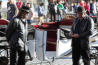 Carriage drivers wearing hats and leather jackets, waiting for tourists in the Old Town square, Prague, Czech Republic The historic centre of Prague was declared a UNESCO World Heritage Site in 1992. Picture by Manuel Cohen