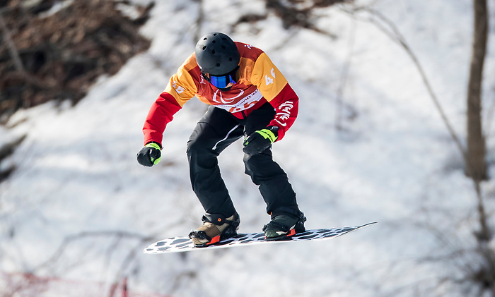 PyeongChang 10/3/2018 - John Leslie during a snowboard cross training session at the Jeongseon Alpine Centre during the 2018 Winter Paralympic Games in Pyeongchang, Korea. Photo: Dave Holland/Canadian Paralympic Committee
