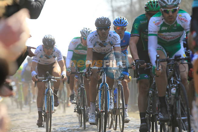Riders tackle the notorious pave section in the Arenberg Forest during the 111th edition of the 2013 Paris-Roubaix cycle race, France 7th April2013 (Photo by Eoin Clarke 2013)