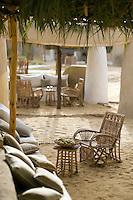 Palm tree fronds are an effective and sustainable option for the awnings shading the terraces