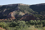 "Palo Duro Canyon State Park, is a canyon which is part of a system of canyons of the Caprock Escarpment in the Panhandle of Texas (USA).  As the second largers canyon in the US, it is roughly 120 minles long and has an average width of 6.2 miles, but reaches a width of 20 miles in some places.  Its depth is aroun 820 feet but in some locations it can drop to 997 feet.  Palo Duro Canyon has been named ""The Grand Canyon of Texas"" both for its size and for the dramatic geological features, including the multicolored layers of rock and steep mesa walls similar to those in the Grand Canyon.  The canyon was formed by the Prairie Dog Town Fork of the Red River which initially winds along the level surface of the Llano Estacado of West Texas, then suddenly and dramatically runs of the Caprock Escarpment.  Water erosion of the millennia has shaped the canyon's geological formations.  Notable canyon formations incluede caves and hoodoos.  One of the best know and the major signature feature of the canyon is the Lighthous Peak.  Amulti-use, six-mile round trip loop trail is dedicated to the formation.  The middle portion of the trail can be hot with little shade, and hikers should take plenty of water.  The painter Georgia O'Keeffe, who lived in nearby Amarillo and Canyon earlyin the 20th century, work of the Palo Duro: ""It is a burning, seethng cauldron, filled wtih dramatic light and color."""
