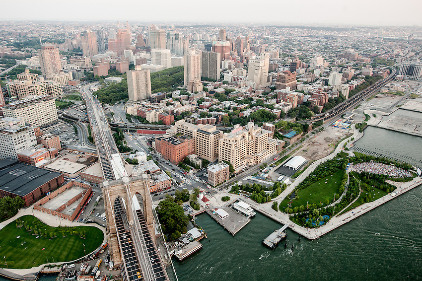 NEW YORK - AUGUST 2: Aerial view of the Brooklyn Bridge and downtown Brooklyn on  August 2, 2012 in New York City. Brooklyn is the most populous of New York's five boroughs.
