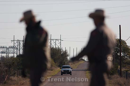 "Eldorado - Texas State Troopers Sgt. Stan Waters (fur collar) and Martin Molotsky manning a roadblock on road CR-300, which leads to the FLDS YFZ ""Yearning for Zion"" compound outside of Eldorado, Texas, Saturday, April 5, 2008."