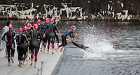 10 AUG 2014 - LIVERPOOL, GBR - Competitors dive off  the pontoon for the deep water start of the elite women's wave at the Tri Liverpool triathlon in Kings Dock in Liverpool, Great Britain (PHOTO COPYRIGHT © 2014 NIGEL FARROW, ALL RIGHTS RESERVED)