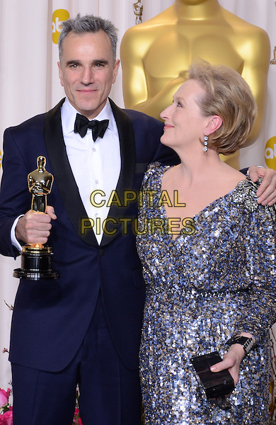 Daniel Day-Lewis, Meryl Streep.85th Annual Academy Awards held at the Dolby Theatre at Hollywood & Highland Center, Hollywood, California, USA..February 24th, 2013.pressroom oscars half length silver grey profile looking up gray beads beaded dress black tuxedo white shirt arm over shoulder award blue winner trophy .CAP/ADM/RE.©Russ Elliot/AdMedia/Capital Pictures.
