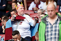 An Aston Villa fan with crown on her head during the Premier League match between Arsenal and Aston Villa at the Emirates Stadium, London, England on 22 September 2019. Photo by Carlton Myrie / PRiME Media Images.