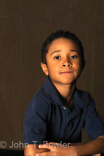 Marcus, young pre-teen African American boy in studio portrait, model released